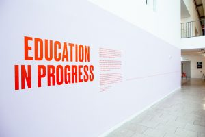 Education in Progress title written on wall