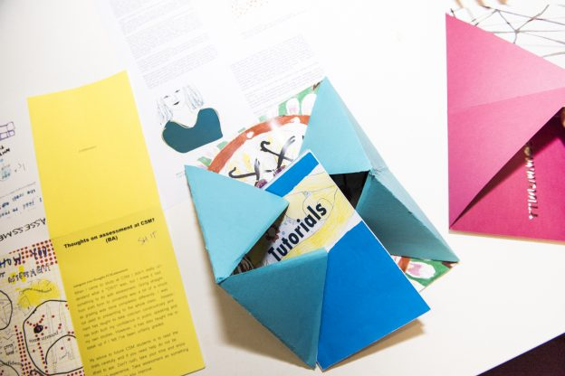 Zine on 'tutorials' with paper folded into triangular design