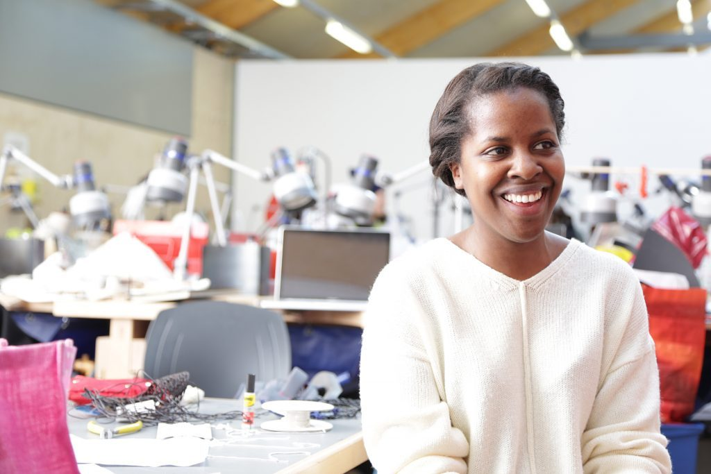 Black female student smiling in a fashion studio
