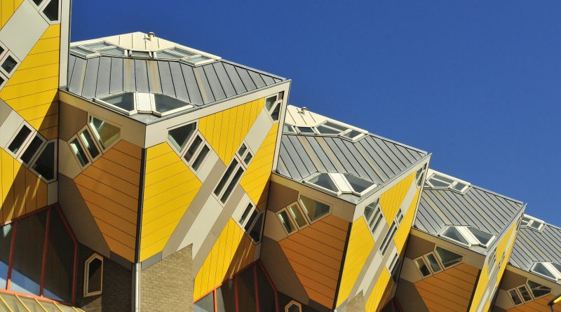 Four unusual yellow cube houses against blue sky in Rotterdam