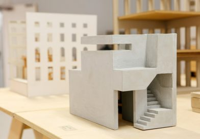 Small concrete model of a building sitting on a tabletop