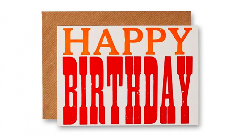 Letterpress card saying Happy Birthday, printed in orange and red on a cream card