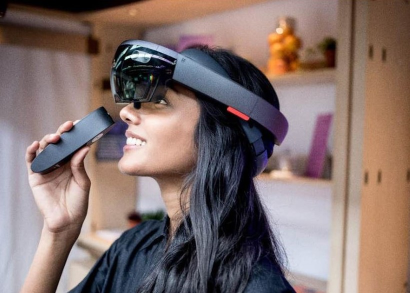 Close up, side vew, of a woman with long dark hair wearing a VR headset